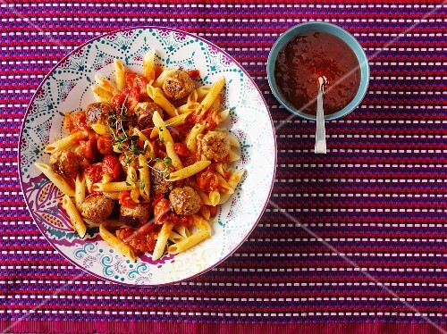 Penne with meatballs and tomatoes