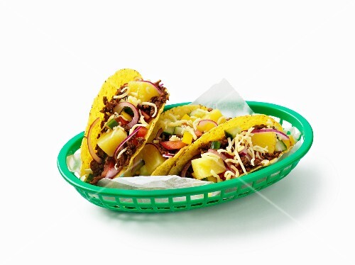 Tacos filled with minced meat and fruit