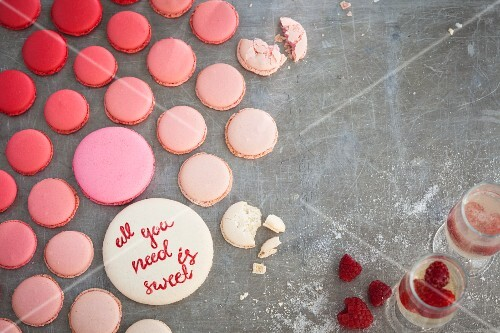 Various pink macaroons and champagne with raspberries