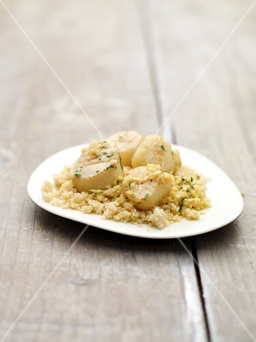 Couscous with scallops and saffron sauce