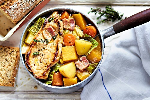 Hearty vegetable stew with apple wine and pork