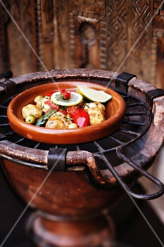A plate of chicken and vegetables on a grill, Marrakesh, Morocco