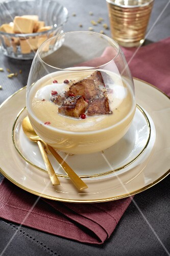Coconut soup with fried diced goose liver