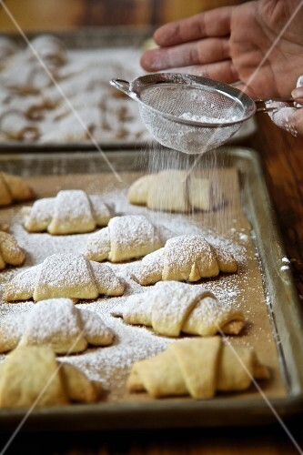 Rugelach or Rogaliki (Russian jam pastries) on a baking tray