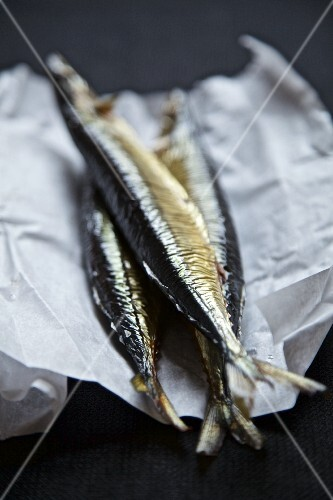 Smoked herring from Russia on a piece of paper