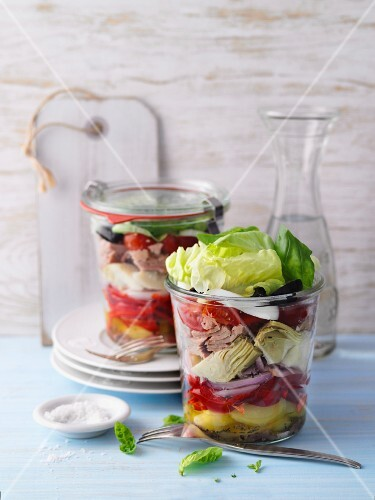 Layered salad Niçoise with tuna fish in jars