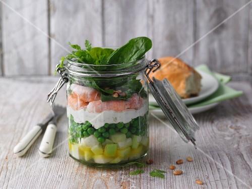 Layered kohlrabi and crayfish cocktail in a jar