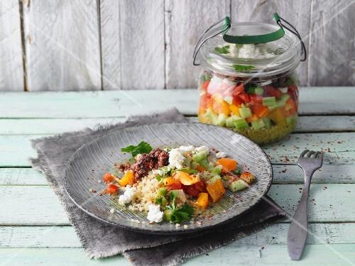 Layered Turkish bulgur and minced meat salad in a jar