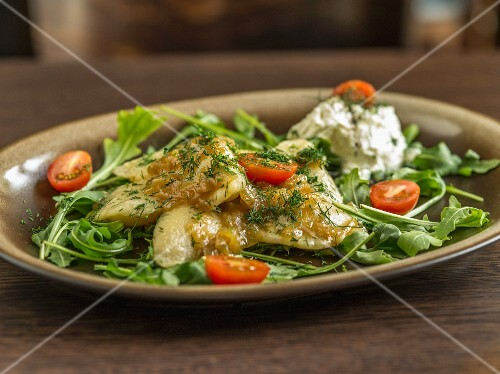 Fish with dill, cocktail tomatoes and rocket