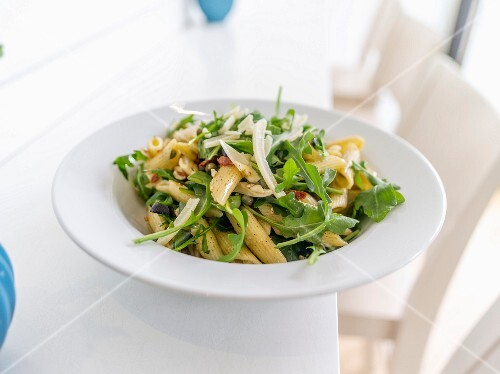 Pasta salad with rockets, dried tomatoes and Parmesan cheese