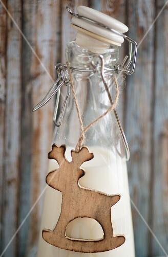 Reindeer pendant on milk bottle