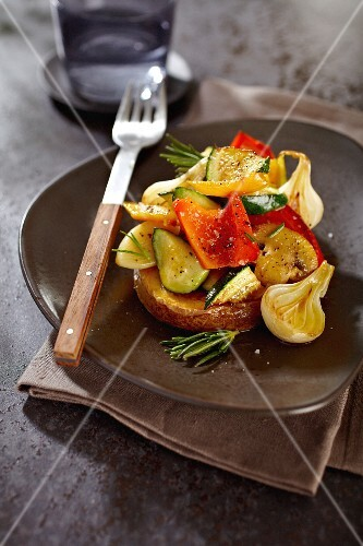Oven baked potato with grilled vegetables and rosemary