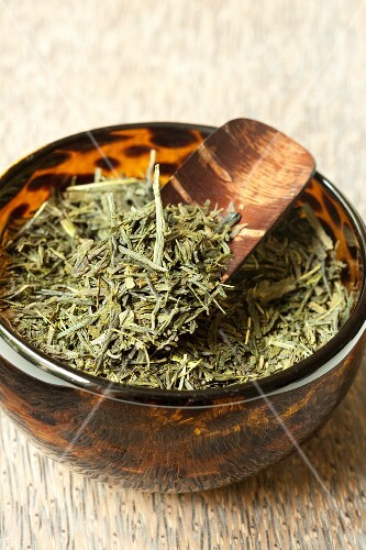 Sencha tea in a glass bowl