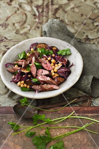 Aubergine salad with lamb and red onions