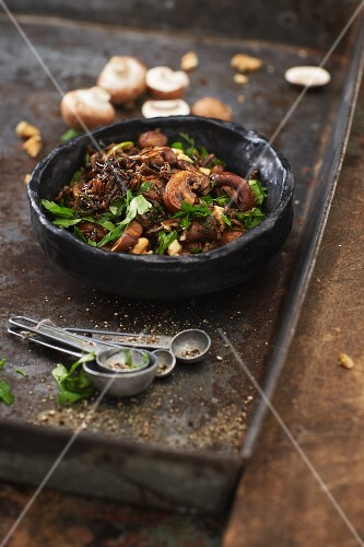 Mushroom salad with black rice and a walnut dressing