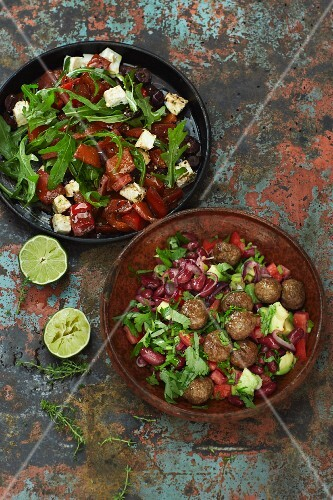 Chilli con carne salad with meatballs and peperonata salad with feta cheese and rocket