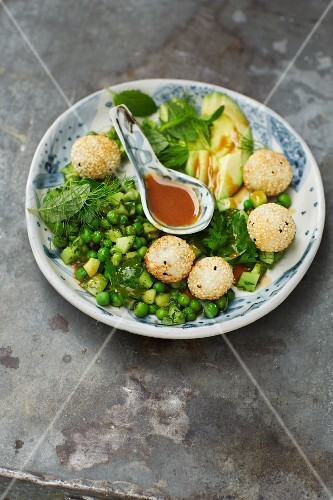 Avocado and pea salad with sticky rice balls and a miso dressing