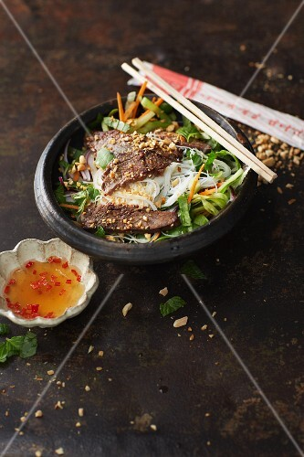 Thai beef salad with rice noodles and peanuts