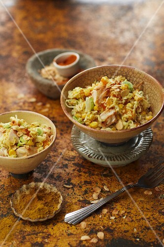 Rice salad with chicken, flaked almonds and a curry and orange dressing