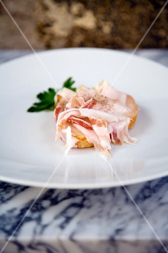 Crostone al lardo di cinta senese (grilled bread topped with bacon, Italy)