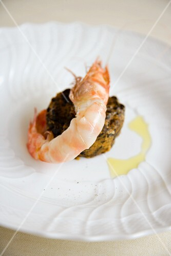 Sparnocchi con lardo di Colonnata e farinata di cavolo nero (a prawn canapé with lardo and black kale, Italy)