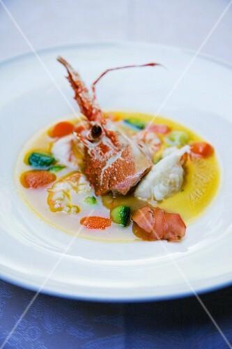 Crostacei e gallinella in brodetto chiarificato di cacciucco (fish and seafood soup, Italy)