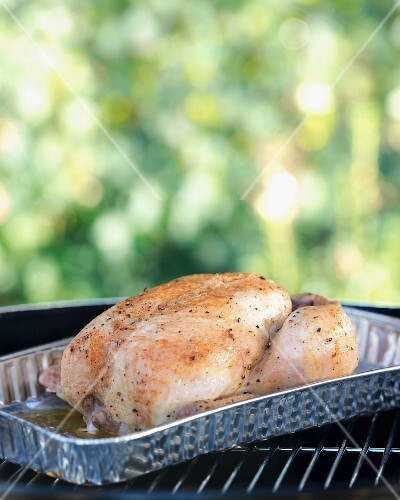 A spring chicken on a barbecue