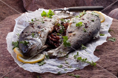 Fried trouts filled with dried tomatoes