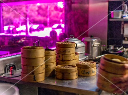 Stacks of bamboo steamers in a restaurant kitchen