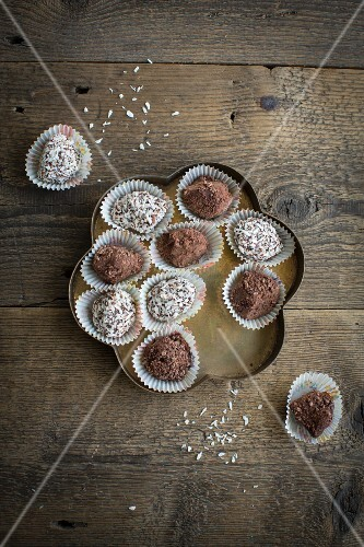 Chocolate spread truffles with cocoa powder and grated coconut