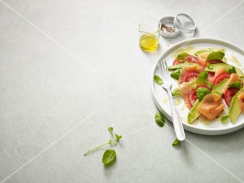 Avocado salmon caprese with fresh basil (Paleo diet)