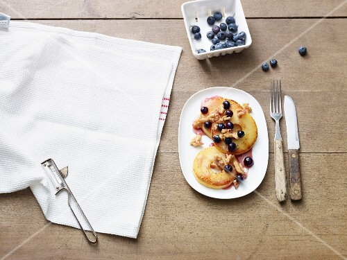 Fried apple rings with walnuts and blueberries (Paleo diet)