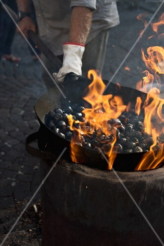 Chestnuts being fried in a large pan