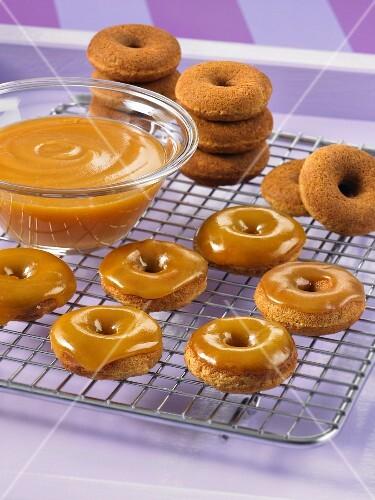 Vanilla and coconut doughnuts with caramel glaze