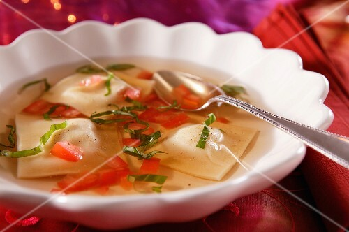 Tomato consommé with ravioli