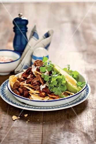 Chilli con carne with steak, nachos and avocado