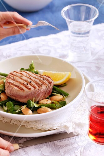 Tuna fish steak on a bed of white beans