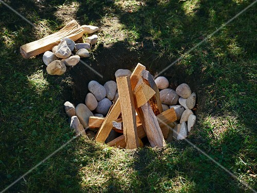 A pit of stones and firewood for a Luau feast