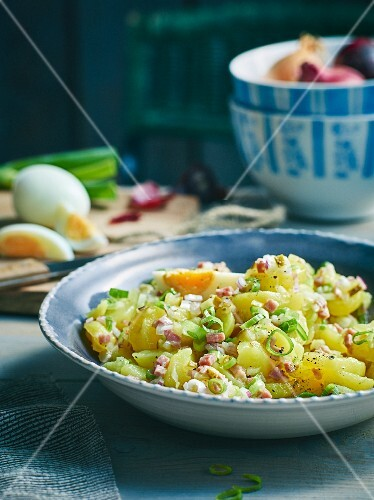 Potato salad with diced bacon and three types of onions