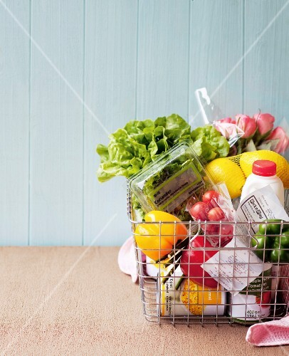 Various foods in a shopping basket