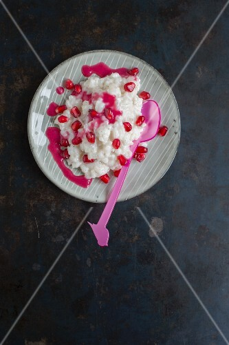 Coconut rice pudding with pomegranate seeds