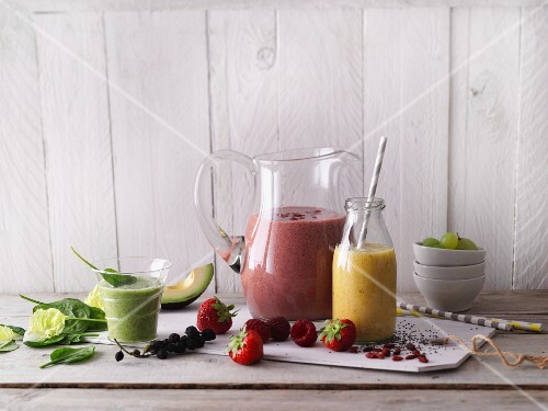Red, yellow and green smoothies made with fruits and vegetables