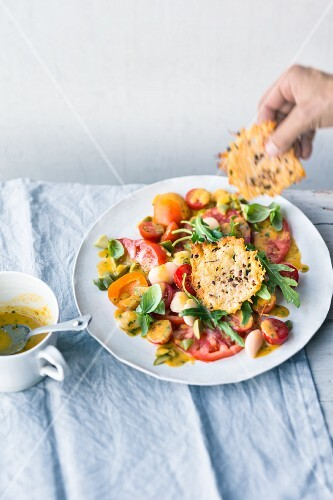 Tomato and apricot salad with Parmesan wafers