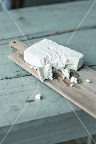 Feta cheese on a chopping board