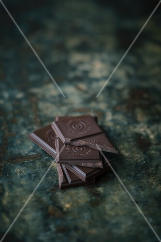 A stack of dark chocolate pieces