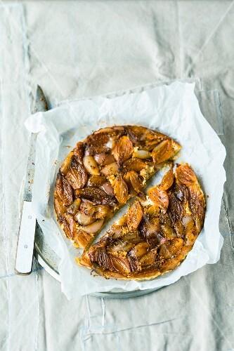 Shallot tarte tatin with feta cheese and cumin seeds