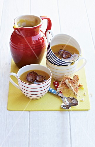 Butternut squash soup with sausage and toast