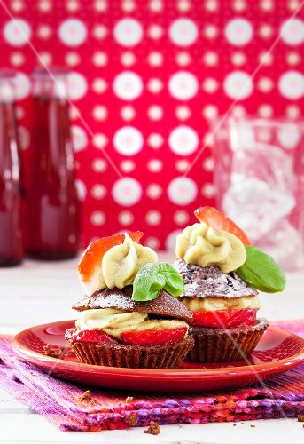 Strawberry and chocolate cupcakes with a lime and basil topping