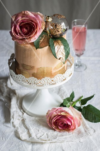 Chiffon cake with roses and sparkling rosé wine for Christmas