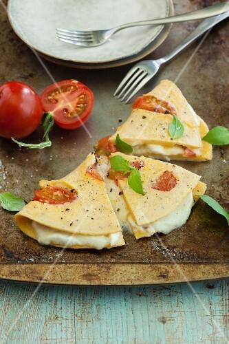 Vegetarian tomato and mozzarella omelette with fresh basil